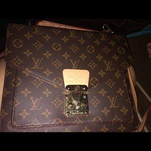 LOUIS VUITTON canvas Monceau bag with strap.
